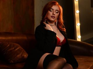 ErrinRis - I like to listen music, draw and cook ) Hot games together , creative clothes ) - I am redhead girl with big breasts and nice body. If you want me to perform it for you i am waiting here in my room. Come to me dear  ;)